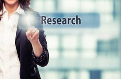 Research. Business woman pressing Research button at her office stock photo