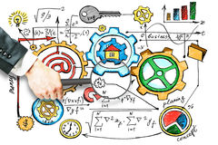 Research concept. Hand holding magnifier over colorful business sketch. Research concept Royalty Free Stock Image