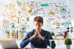 Research concept. Thoughtful young businessman at workplace with business drawings. Research concept Stock Photo