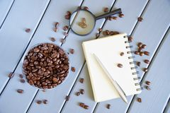 Research of consumer qualities of products. Analysis of roasted coffee beans royalty free stock photos