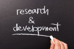 Research and Development. Hand writing Research and Development topic on chalkboard Royalty Free Stock Image