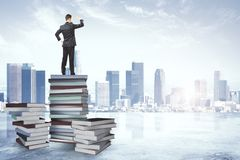 Research, education and employment concept. Back view of young businessman standing on abstract book pile and looking into the distance on bright city background vector illustration
