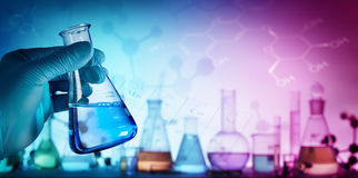 Research And Innovation - Beaker With Formula. In Laboratory royalty free stock photos