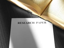 Research Paper. An open old reference book with a blank research paper sheet Royalty Free Stock Images
