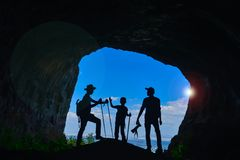 Research, photography and discovery curiosity. Group exploration ;cave and closed area sightseeing and walking Stock Image