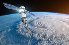 Research, probing, monitoring hurricane Florence raging on the coast. Satellite above the Earth makes measurements of the weather. Parameters. Elements of this stock photography