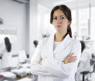 Research professor. Cute brunette in white medical gown in a research medical laboratory stock photography