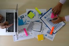 Research stock market chart paper for analysis Brainstorm Meeting research. W stock photography
