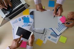 Research stock market chart paper for analysis Brainstorm Meeting research. W royalty free stock photo