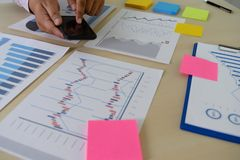 Research stock market chart paper for analysis Brainstorm Meeting research. W stock photos
