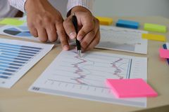 Research stock market chart paper for analysis Brainstorm Meeting research. W royalty free stock photos