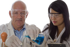 Research team holding flask with chemicals Stock Image