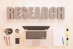 Research text concept. Research - text concept with notebook computer, smartphone, notebook and pens on wooden desktop. 3D render illustration Stock Images
