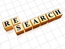 Research text in golden cubes. Research black text in 3d golden cubes Stock Image