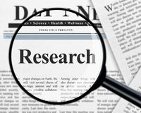 Research under magnifying glass royalty free stock photo