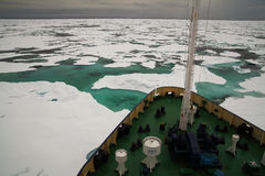 Research vessel in icy arctic sea. Research vessel in an icy arctic sea Stock Photos