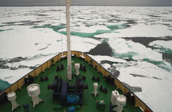 Research vessel in icy arctic sea on. Research vessel in an icy arctic sea on a dull day Royalty Free Stock Photography