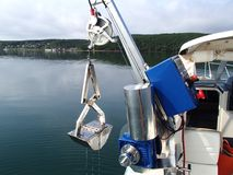 Research winch recovering benthic grab with sample from the sea bottom. Science equipment: research winch recovering benthic grab with sample from the sea bottom Stock Image