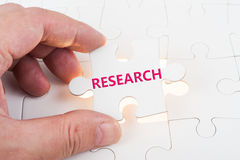 Research word on puzzle Stock Photo