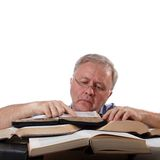 Research work. Man with glasses working with many books Royalty Free Stock Photo