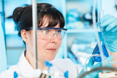 Researcher. Scientific researcher holding at a liquid solution in a lab Stock Photos