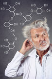 Researcher with chemistry formulas Stock Photos