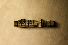 RESEARCHER - close-up of grungy vintage typeset word on metal backdrop. Royalty free stock illustration.  Can be used for online banner ads and direct mail Stock Photos
