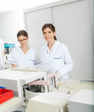 Researcher With Colleague In Laboratory Royalty Free Stock Photos