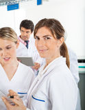 Researcher With Colleague In Laboratory Stock Photo