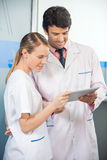 Researcher And Colleague Using Digital Tablet Stock Image