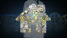 Researcher, Engineer touching screen, big gears gathered idea bulb shape animation. stock video