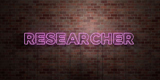 RESEARCHER - fluorescent Neon tube Sign on brickwork - Front view - 3D rendered royalty free stock picture. Can be used for online banner ads and direct Royalty Free Stock Images
