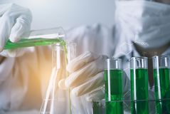 Researcher with glass laboratory chemical test tubes with liquid. For analytical , medical, pharmaceutical and scientific research concept Royalty Free Stock Image