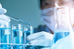 Researcher with glass laboratory chemical test tubes with liquid Royalty Free Stock Photo