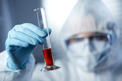 Researcher in hazmat suit with test tube Royalty Free Stock Image