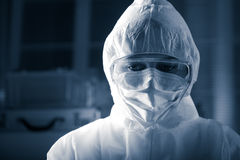 Researcher in hazmat suit. Researcher wearing hazmat protective suit and safety goggles Royalty Free Stock Photography