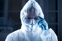 Researcher in hazmat suit. Researcher wearing hazmat protective suit and safety goggles Royalty Free Stock Photo