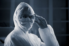 Researcher in hazmat suit Stock Photo