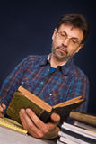 Researcher with his books Stock Image