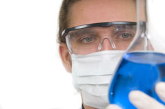Researcher holding flask with chemicals Royalty Free Stock Images