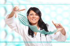 Researcher Holding Up A DNA Strand Stock Image