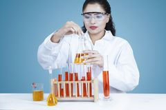 Researcher holds chemical liquid in test tube Stock Image