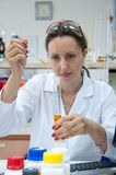 Researcher holds pipette Royalty Free Stock Photo