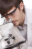 Researcher looking in microscope Royalty Free Stock Photo