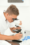 Researcher with microscope Stock Photography