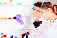 Researcher observing indikator colour shift. Stock Photos