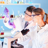 Researcher observing indikator colour shift. Stock Photo