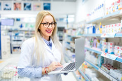 Researcher and pharmaceutical scientist using laptop and internet for business. Medical researcher and pharmaceutical scientist using laptop and internet for Royalty Free Stock Images