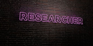 RESEARCHER -Realistic Neon Sign on Brick Wall background - 3D rendered royalty free stock image. Can be used for online banner ads and direct mailers Stock Images