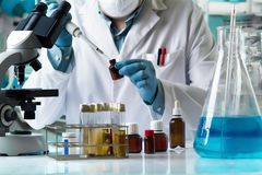 Researcher taking reactive with pipette for analysis in the rese. Scientist holding pipette and tube for taking samples mixed for tube test. Researcher taking Royalty Free Stock Photography